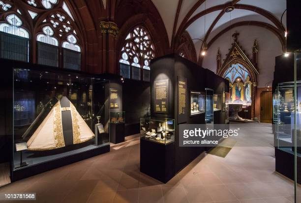 Showcases with the exhibits of the cathedral treasure stand in the former Nikolaus chapel of Mainz Cathedral The Cathedral Treasury in the Chapel of...