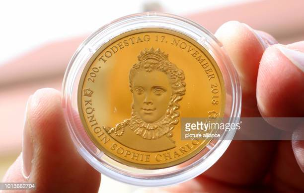 One of the strictly limited commemorative coins in gold commemorating the 200th anniversary of the death of British Queen Sophie Charlotte shows...