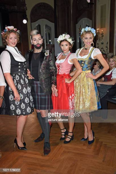 Designer Harald Glööckler presents his exclusive Dirndl collection designed for the traditional company Angermaier with models as part of a show...