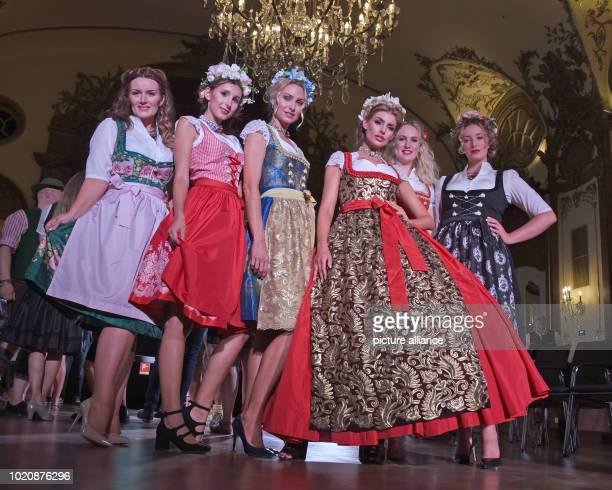 Models present the Dirndl collection of designer Gloockler designed for the traditional company Angermaier Photo Ursula Düren/dpa