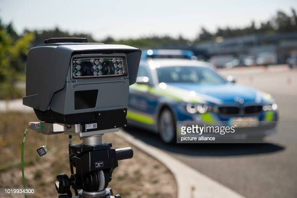 A transportable automated license plate recognition system stands in front of a police car Every month the automatic registration of vehicle number...