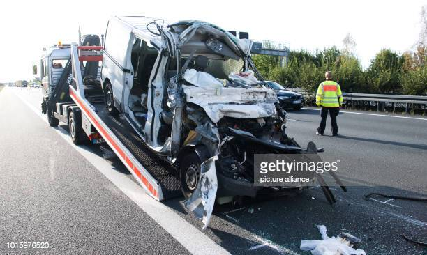 After a serious accident on the A2 motorway between PeineOst and Haeelerwald a completely destroyed van is transported away in the direction of...