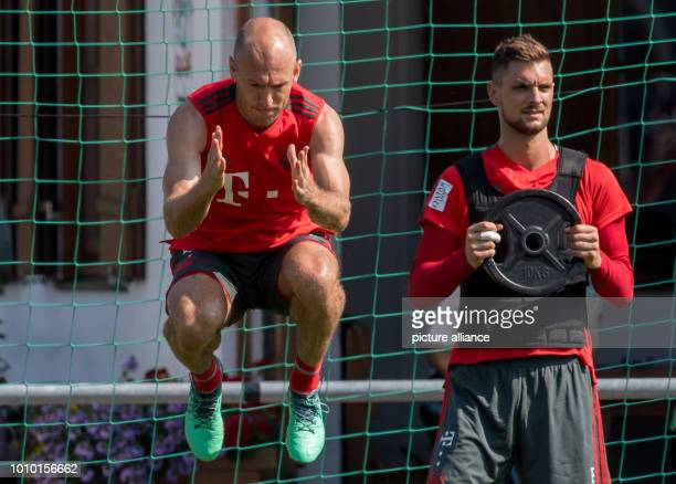 August 2018, Germany, Rottach-Egern: Arjen Robben and goalkeeper Sven Ulreich from FC Bayern Munich participating in the training. The club is...