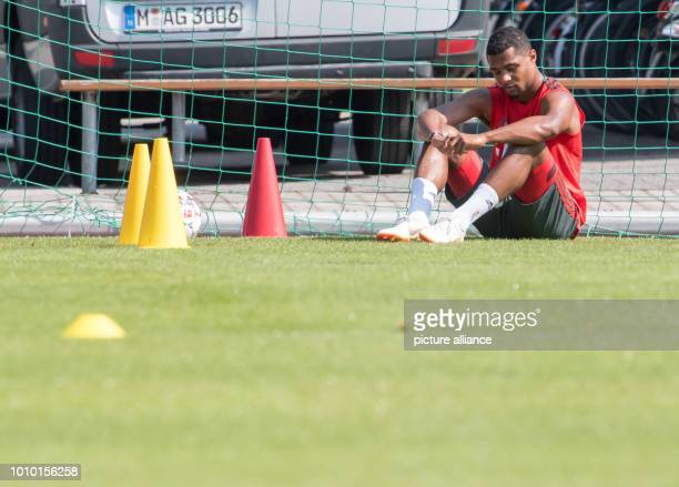 Serge Gnabry of FC Bayern Munich sits on the pitch during practice The club is located for a oneweek training camp at Tegernsee Photo Peter...