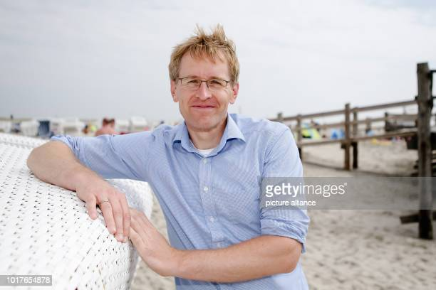 16 August 2018 Germany St Peter Ording Daniel Guenther Prime Minister of SchleswigHolstein leans against a beach chair and looks into the camera...