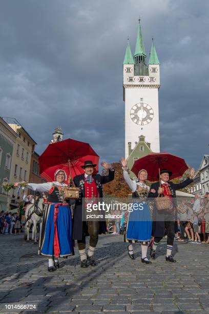 August 2018, Germany, Straubing: Participants of the traditional procession of the Gaeuboden folk festival walk around the old town. The traditional...