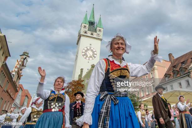 August 2018, Germany, Straubing: Participants of the traditional procession to the Gaeuboden folk festival walk through the old town in traditional...