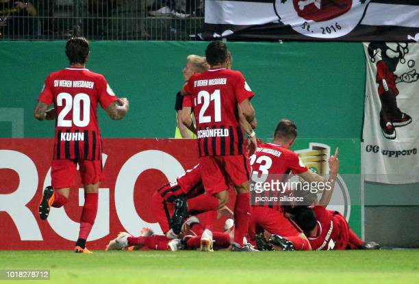 Soccer DFB Cup 1st round SV Wehen Wiesbaden vs FC St Pauli in the BritaArena Players of Wehen Wiesbaden celebrating the 10 goal Photo Hasan...