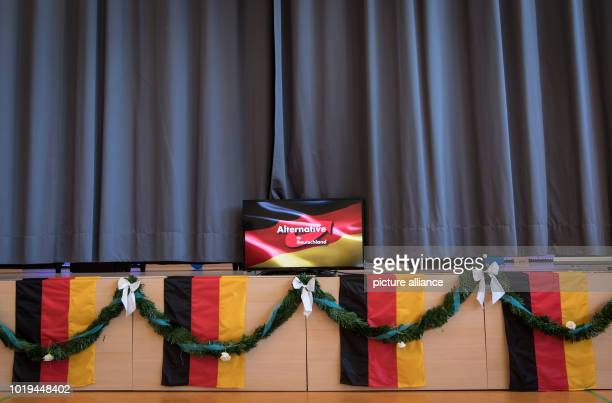 The stage is decorated with Germany flags at the start of the election campaign of the Hessian 'Alternative für Deutschland' in the community centre...