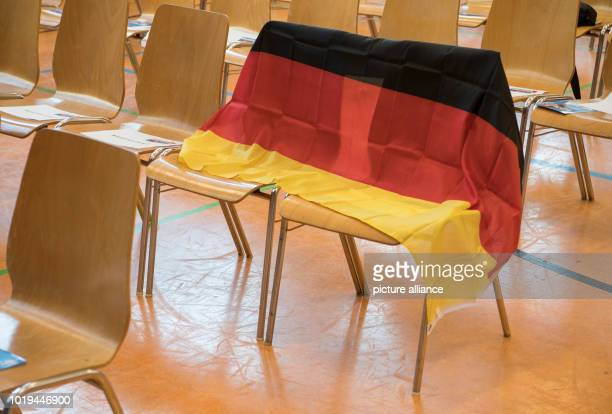A German flag serves as a placeholder at the start of the election campaign of the Hessian 'Alternative für Deutschland' in the community centre in...