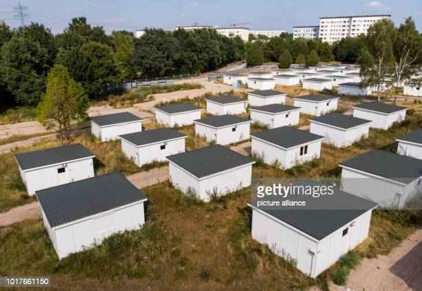 Houses for refugees stand on the grounds of a former refugee shelter in the Jenfeld district The city of Hamburg offers 50 former wooden refugee...