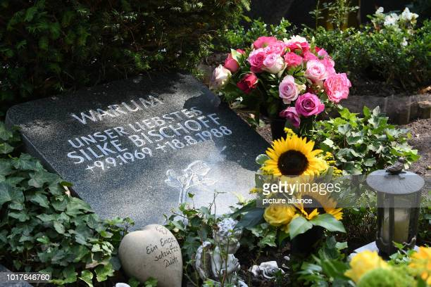 Fresh flowers lie on the grave of the killed Silke Bischoff at the cemetery in Heiligenrode Wreaths were laid in memory of her death on the 30th...