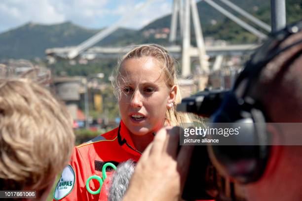 Lucia Mortara a volunteer for the Italian aid organization Anpas speaks to journalists near the collapsed Morandi Bridge The fact that survivors were...