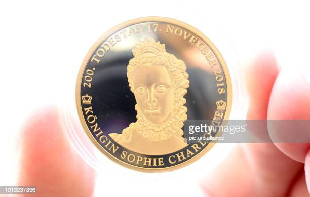One of the limited commemorative coins are shown by Michael Knippschild of Euromint on the 200th anniversary of the death of Queen Sophie Charlotte...