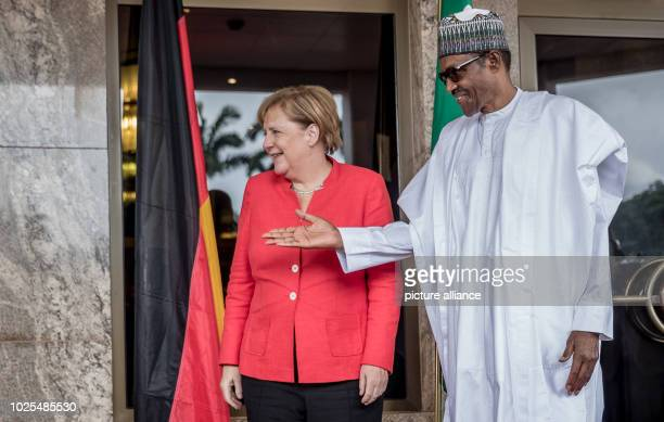 German Chancellor Angela Merkel is welcomed by Muhammadu Buhari President of the Federal Republic of Nigeria Nigeria is the last stop on the...