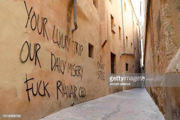 The wall of a historic house in the city centre reads 'Your luxury trip our daily misery fuck Ryanair CEO' Photo Clara Margais/dpa