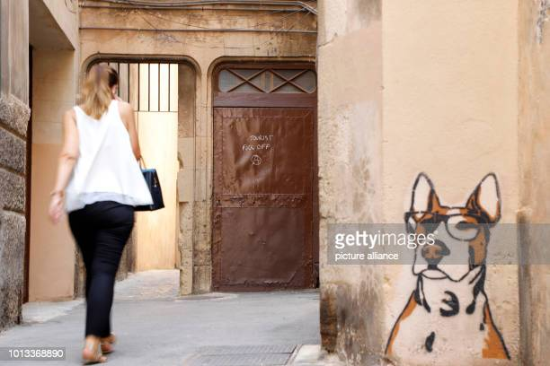 'Tourist fuck off' stands on the door of a house in the city centre Many Mallorcans are annoyed by mass tourism and its side effects crowded streets...