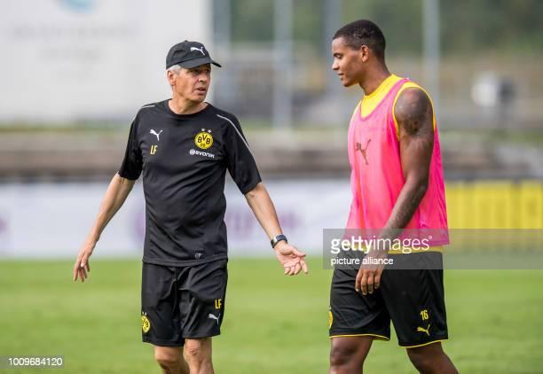 Soccer training camp Borussia Dortmund Dortmund's coach Lucien Favre talks to his player Manuel Akanji Photo David Inderlied/dpa