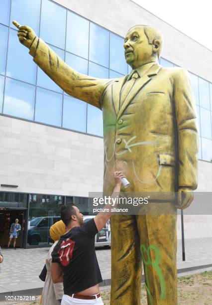 A man sprayed the words 'Fuck you' on a golden Erdogan statue on the Square of German Unity The statue was erected as part of the art festival...