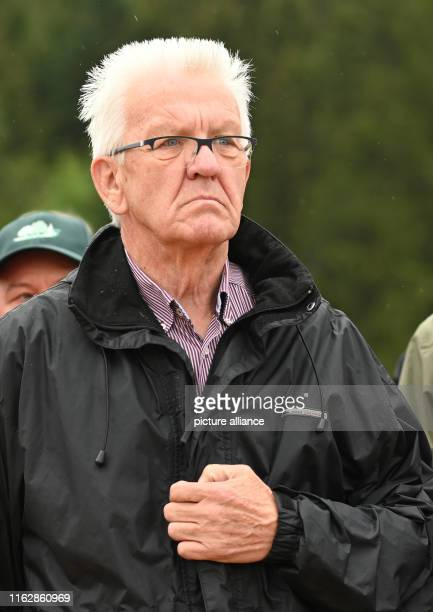20 August 2019 BadenWuerttemberg ÜhlingenBirkendorf Winfried Kretschmann Prime Minister of BadenWürttemberg grabs his jacket during a walk through...