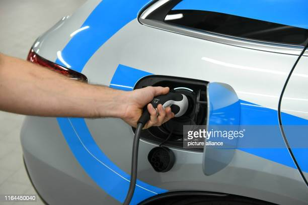 A Mercedes EQC 400 the first purely electric SUV from Daimler is charged with a charging cable in the Berlin Mercedes world at Salzufer Photo Jens...