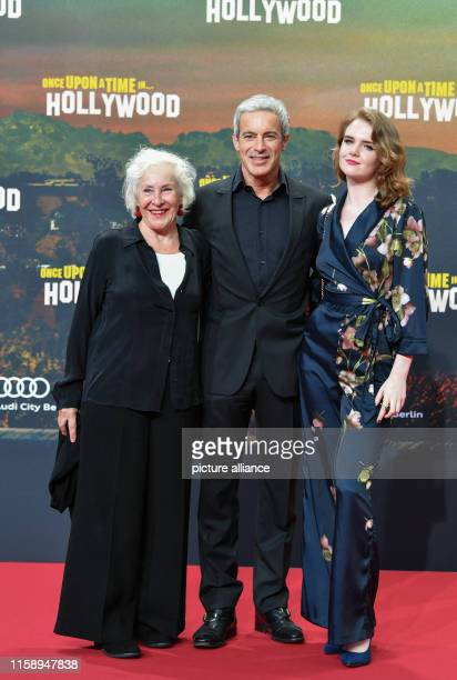 """August 2019, Berlin: Gedeon Burkhard with daughter Gioia and mother Elisabeth von Molo come to the premiere of the movie """"Once upon a time... In..."""