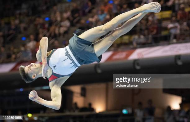 Gymnastics German championship decisions MaxSchmelingHalle men floor Dario Sissakis in action Photo Marijan Murat/dpa