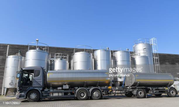 A tanker truck loaded with raw milk stands in front of large containers from Gläsernen Molkerei GmbH Gläserne Molkerei GmbH produces various organic...