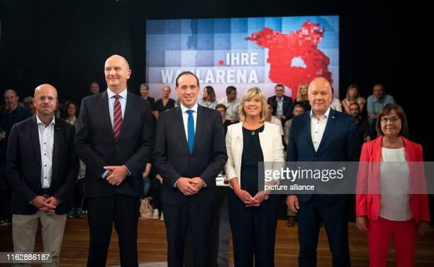 August 2019, Brandenburg, Potsdam: Top candidates for the Brandenburg state elections Andreas Kalbitz , Dietmar Woidke, Minister President of...