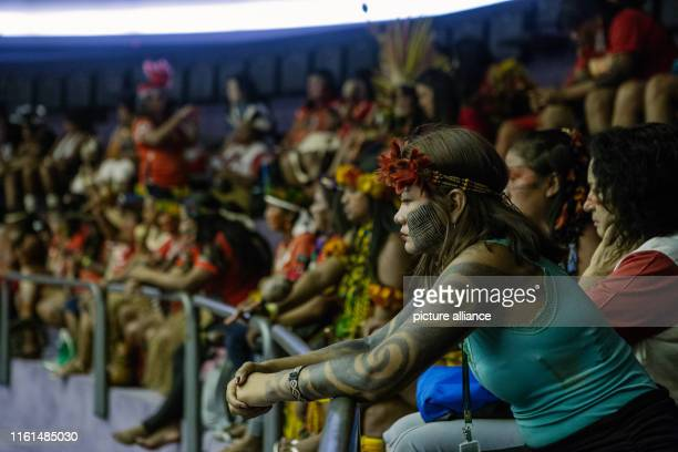 Indigenous women take part in a parliamentary session as part of a protest against President Bolsonaro's government Women from numerous indigenous...