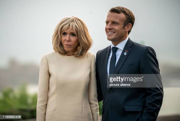 24 August 2019 France Biarritz France's President Emanuel Macron is waiting next to his wife Brigitte at the lighthouse for the guests The G7 summit...