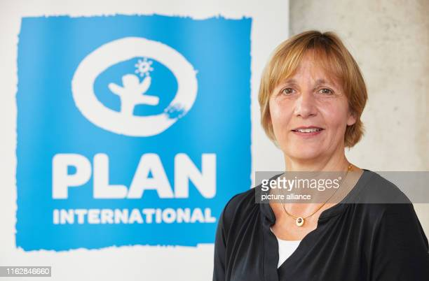 Maike Röttger Managing Director of Plan is standing in front of the aid organisation's logo after a press conference by Plan International on a...