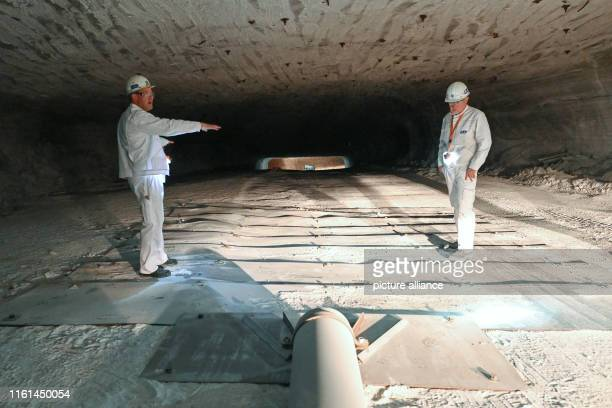 KS employees Bernd Schneider and Johannes Zapp Head of Mining Operations are standing next to the inflow at the deepest point of the new storage...