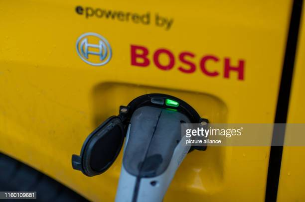 """August 2019, Mecklenburg-Western Pomerania, Wittenburg: An electrically driven parcel transporter """"Streetscooter"""" is charged with electricity at a..."""