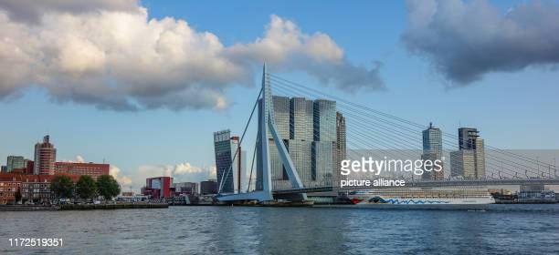 The Erasmus Bridge is a cablestayed bridge over the Nieuwe Maas The cruise ship AIDAbella is located in the harbour Photo Patrick...