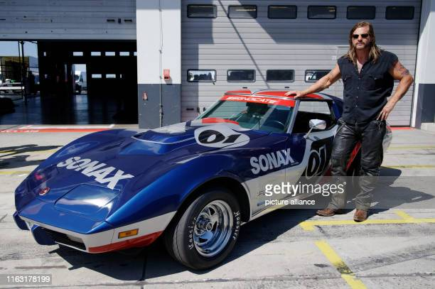 22 August 2019 North RhineWestphalia Nürburgring The actor Henning Baum is standing next to a car during a photo shoot for the movie Asphalt Börning...