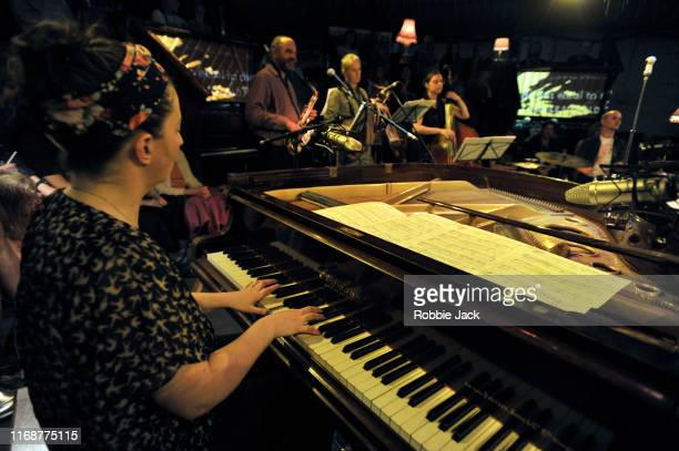 Raymond MacDonald and Friends perform Lie Still My Sleepy Fortune in The Pianodrome the world's first amphitheatre made entirely from pianos as part...