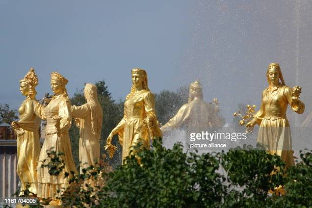 Golden female figures stand at the edge of the fountain of friendship between nations The WDNCh complex in the Russian capital is celebrating its...