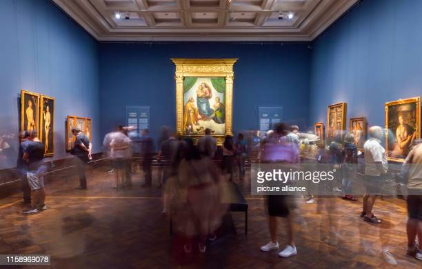 "August 2019, Saxony, Dresden: Visitors walk through the exhibition ""Glanzlichter der Gemäldegalerie Alte Meister"" in the Semper Building . In the..."