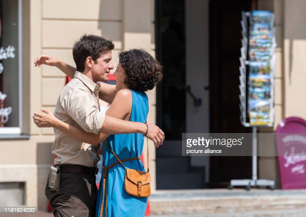 Actress Liza Tzschirner and Philipp Danne actor in the role of Ranger embrace each other on the market square during the shooting of the ARD...