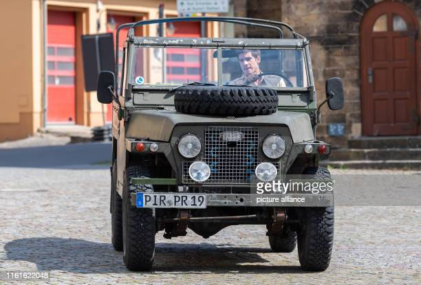 During the shooting of the ARD television film Der RangerParadies Heimat Philipp Danne actor drives across the marketplace in a jeep in the role of...