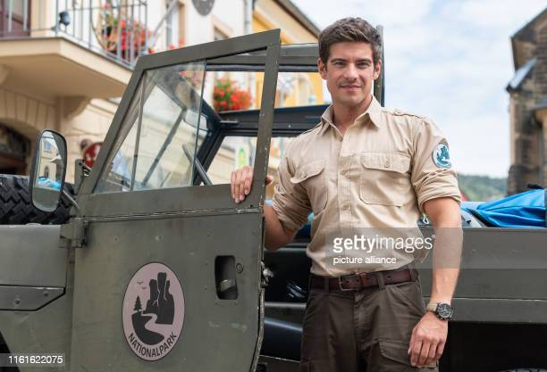 Philipp Danne actor is on the sidelines of shooting the ARD television film Der RangerParadies Heimat in the role of the ranger in front of a jeep on...