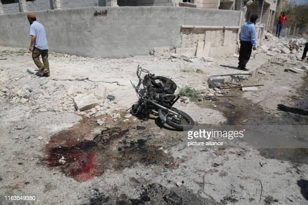 Bloods are seen next to a damaged motorcycle after an explosion hits a residential neighbourhood Two people dead and dozens get injured Photo Anas...