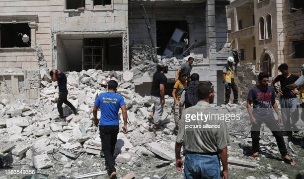 People inspect the damage after an explosion hits a residential neighbourhood Two people dead and dozens get injured Photo Anas Alkharboutli/dpa
