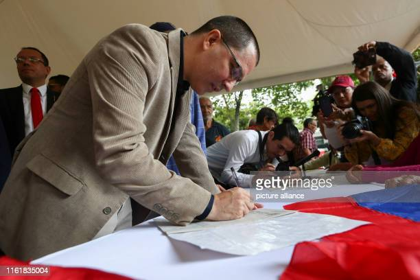 Jorge Arreaza foreign minister of Venezuela signs documents against the recent US santkions against the Venezuelan government The Venezuelan...