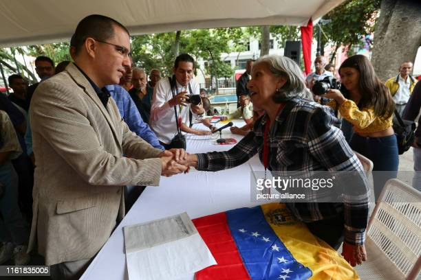 Jorge Arreaza Venezuelan foreign minister shakes hands with a supporter as he comes to an event against the recent US sanctions against the...