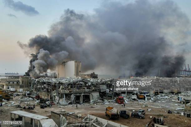 August 2020, Lebanon, Beirut: Thick Smoke billows from the site where a massive explosion rocked Beirut's port. Photo: Marwan Naamani/dpa