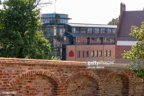 August 2020, Mecklenburg-Western Pomerania, Bergen: Behind a historic monastery wall, the logo of the savings banks can be seen. Photo: Stephan...