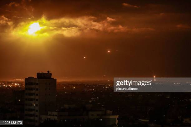 August 2020, Palestinian Territories, Gaza City: The Iron Dome anti-missile system fires interceptor missile as rockets are launched from Gaza...