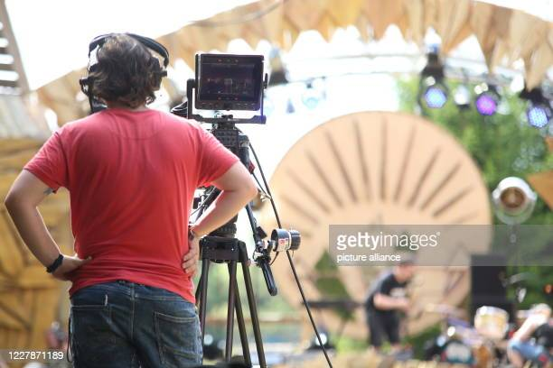 """August 2020, Saxony-Anhalt, Elend: A cameraman stands in front of the stage. Due to the Corona pandemic, this year's """"Rocken am Brocken"""" festival is..."""
